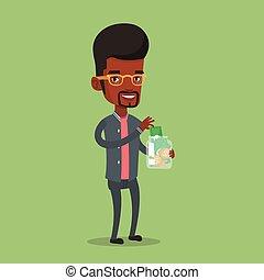 Businessman putting dollar money into glass jar.