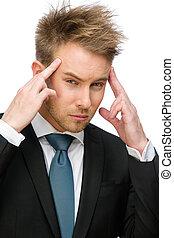 Businessman putting hands on head
