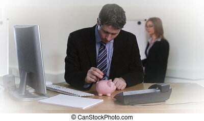 Businessman putting money in his piggybank
