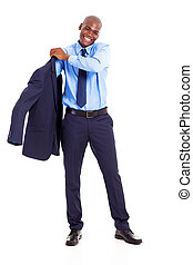 businessman putting on jacket