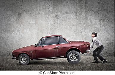 man raises car