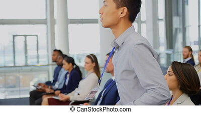 Businessman raising hand in the business seminar 4k - Side ...