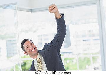 Businessman raising up his hand