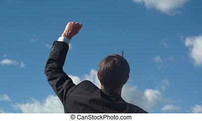 Businessman Raising Victory Arm - Close up shot of the back...