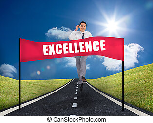 Businessman reaching a banner with excellence written on it ...