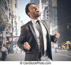 Businessman reaching a goal - Businessman screaming happy...