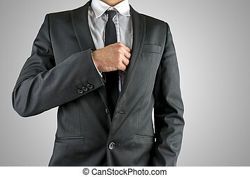 Businessman reaching inside his breast pocket