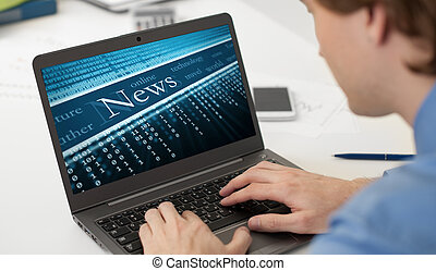 businessman reading business news on his laptop