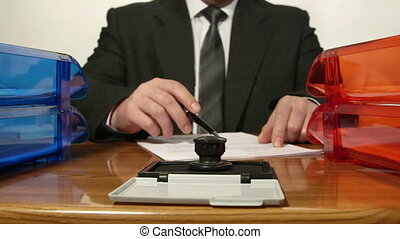 Businessman reading document and signs it