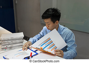 Businessman reading document in the meeting room