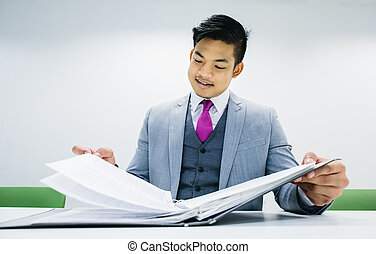 Businessman reading documents