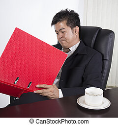 businessman reading his job