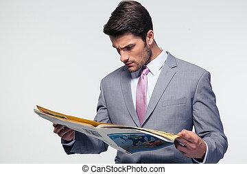 Businessman reading magazine