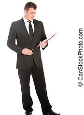 Businessman reading notes on a clipboard