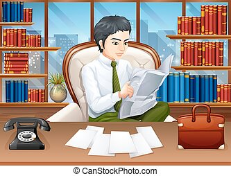 Businessman reading papers in the office