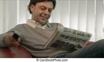 Businessman reading real estate ads