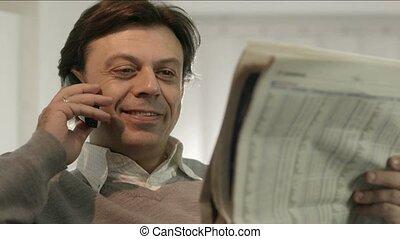 Businessman reading stock exchange