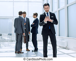 businessman reading text message on smartphone