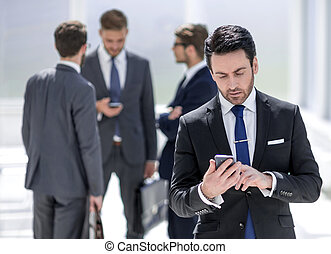 businessman reading text on smartphone