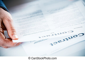 Businessman reading through a business contract