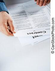 Businessman reading through a contract