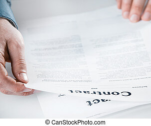Businessman reading through a legal contract