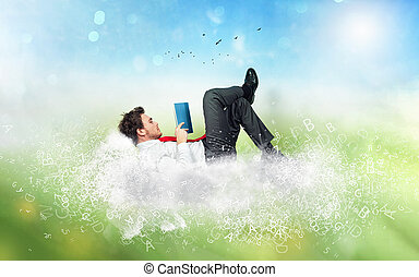 Businessman reads a book over a cloud made of letters. Concept of relax and imagination