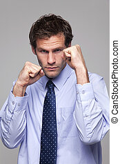 Businessman ready to do battle - Businessman in shirt and...