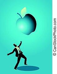 Businessman receiving a fallen big apple