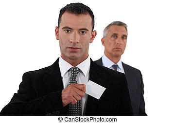 Businessman receiving card