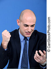 businessman receiving great news on his cell phone