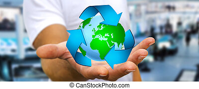 Businessman recycling concept - Businessman holding...