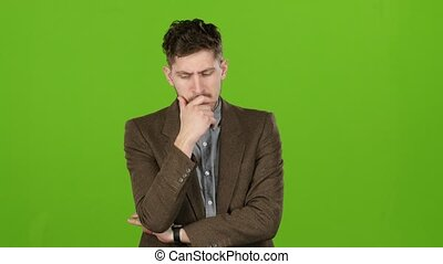 Businessman reflects on the affairs, looking for solutions to problems. Green screen