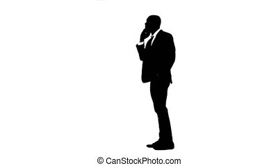 Businessman rejoices in the victory and speaks on the phone. White background. Silhouette