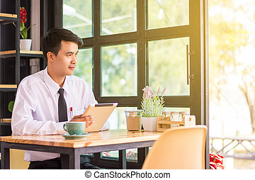 Businessman relaxing in a cafe.