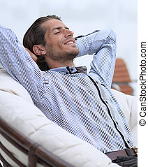 businessman relaxing in a comfortable chair