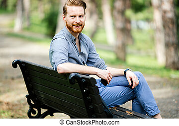 Businessman relaxing in nature
