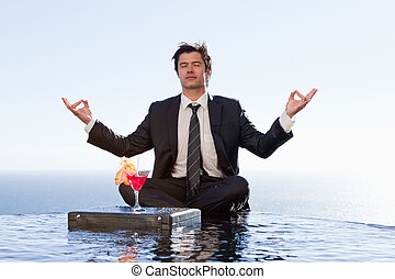 Businessman relaxing in the lotus position