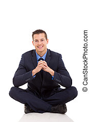 businessman relaxing on floor