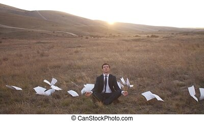 Businessman relaxing on nature - Young businessman relaxing...