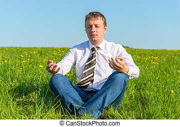 businessman relaxing relieves stress in the field