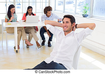 Businessman relaxing with colleague