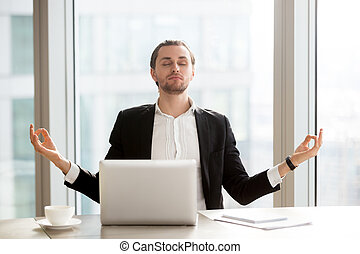 Businessman relieves work stress with meditation