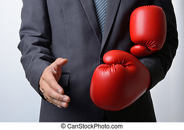 Businessman remove red boxing gloves to offer a handshake on white background, compromise concept
