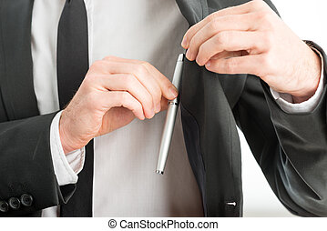 Businessman removing a pen from his pocket