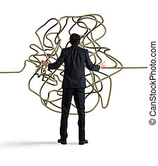 Businessman resolves the tangle - Businessman looks confused...