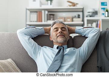 Businessman resting on the sofa