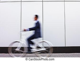 Businessman riding bicycle