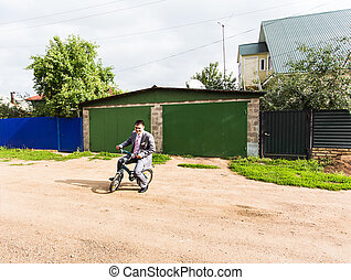 Businessman riding child's bicycle