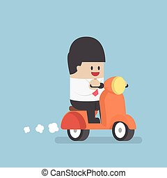 Businessman riding on a scooter